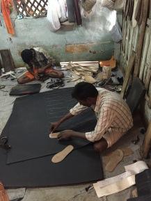 shoe makers in poor urban setting