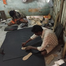shoe makers in poor urban setting